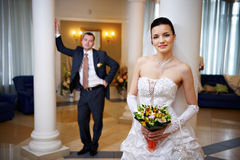 Happy bride and groom in wedding palace Stock Photo