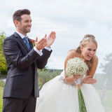 Happy bride and groom at wedding reception stock photos