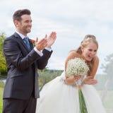 Happy bride and groom at wedding reception Stock Photos