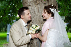 Happy bride and groom at wedding walk royalty free stock images