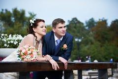 Happy bride and groom on wedding walk Royalty Free Stock Image
