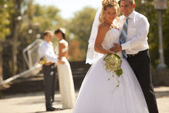 Happy bride and groom at the wedding walk Stock Image