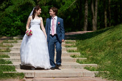 Happy Bride and groom at wedding walk stock photography