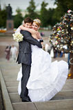 Happy bride and groom at wedding walk on bridge. Happy bride and groom at a wedding a walk on Luzhkov bridge in Moscow Royalty Free Stock Image