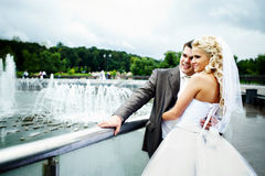 Happy bride and groom at wedding walk on bridge Stock Photography