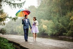 Happy Bride and groom at wedding walk with color Stock Photography