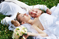 Happy bride and groom at wedding walk on grass Stock Photo