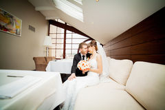 Happy bride and groom on the wedding walk in the modern hotel ha Royalty Free Stock Image