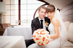 Happy bride and groom on the wedding walk in the modern hotel ha Stock Photos
