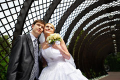 Happy bride and groom at wedding walk in the park stock photo