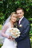 Happy bride and groom in wedding walk in park. Happy bride and groom in wedding a walk in the park Stock Photos