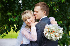 Happy bride and groom in wedding walk in park Stock Image