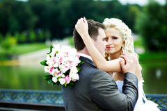 Happy bride and groom at wedding walk in park Royalty Free Stock Photos