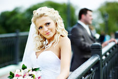 Happy bride and groom at wedding walk in park Royalty Free Stock Photography