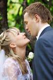 Happy bride and groom in wedding walk in park Stock Images