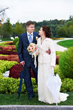 Happy bride and groom at wedding walk in park Royalty Free Stock Image