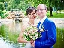 Happy bride and groom on wedding walk Stock Photo
