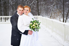 Happy bride and groom on winter park Stock Photo