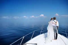 Happy bride and groom on a yacht Royalty Free Stock Photo