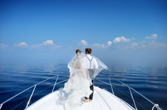Happy bride and groom on a yacht Stock Image