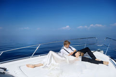 Happy bride and groom on a yacht Royalty Free Stock Photos