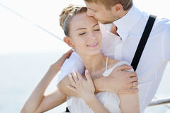Happy bride and groom on a yacht Stock Photography