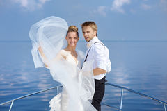 Happy bride and groom on a yacht Stock Photo