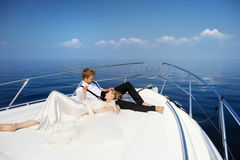 Happy bride and groom on a yacht Stock Images