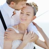 Happy bride and groom on a yacht Royalty Free Stock Images