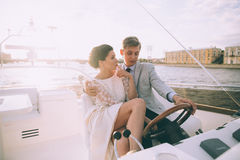 Happy bride and groom on a yacht traveling together Stock Photography