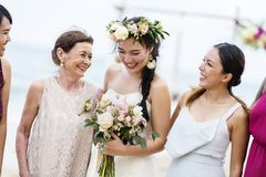 Happy bride and guests at her wedding stock image