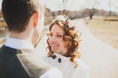 Happy bride and happy groom having walk in park Stock Images