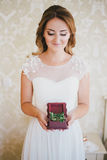 Happy bride having her wedding preparations Stock Photography