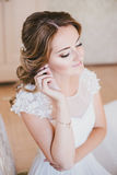 Happy bride having her wedding preparations. Wedding hairstyle Royalty Free Stock Photos