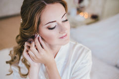 Happy bride having her wedding preparations. Wedding hairstyle Stock Photography