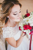 Happy bride having her wedding preparations. Wedding hairstyle Stock Photo