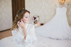 Happy bride having her wedding preparations. Wedding hairstyle Stock Photo