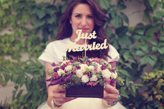 Happy bride hoding a just married sign Stock Photos