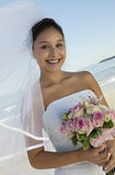 Happy Bride Holding Flower Bouquet On Beach Stock Photos