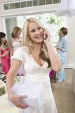 Happy Bride Holding Gift And Communicating On Mobile Phone Royalty Free Stock Photography