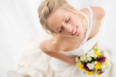 Happy bride holding her wedding bouquet Stock Photography