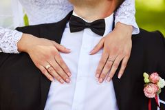 Happy bride hugging the groom with hands. Close-up portrait of a bride and groom royalty free stock photos