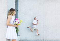 The happy bride and the jumping groom. Stock Photography