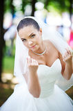 Happy bride keeps veil Royalty Free Stock Image