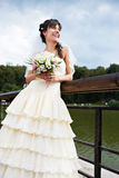 Happy bride about lake Royalty Free Stock Image