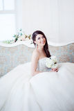 Happy bride laughing, girl with a bouquet of flowers. Wedding decoration Royalty Free Stock Image