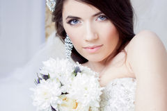 Happy bride laughing, girl with a bouquet of flowers. Wedding decoration Stock Images