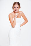 Happy bride making silence sign Royalty Free Stock Images