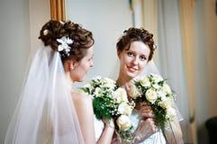 Happy bride in mirror stock photo