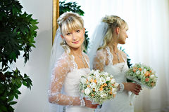 Happy bride about mirrors in wedding palace Stock Images